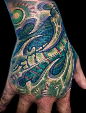 Biomech Hand Tattoo by Las Vegas Tattoo Artist Joe Riley