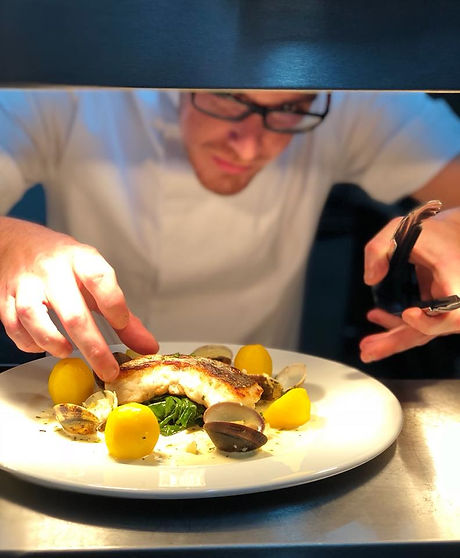 Head Chef Rob plating up on the pass