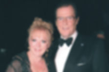 Gay and Sir Roger Moore.jpg