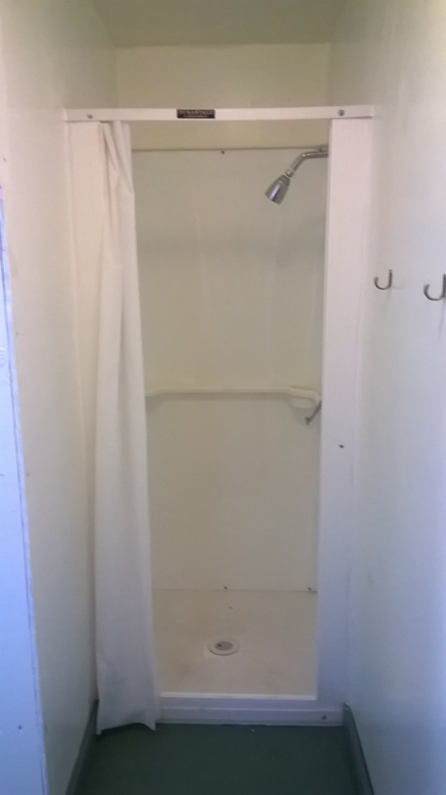 A small bathroom with a shower