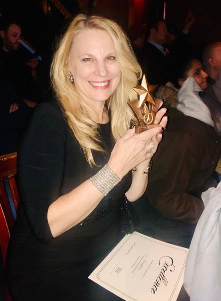 "Linda Collins accepts the ""Best International Film"" award!"