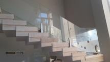 Guarda corpo vidro e inox em escada