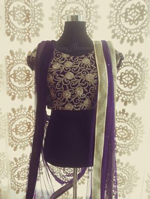 Customised bridal lehenga blouse with velvet and gold zari and stone embroidery