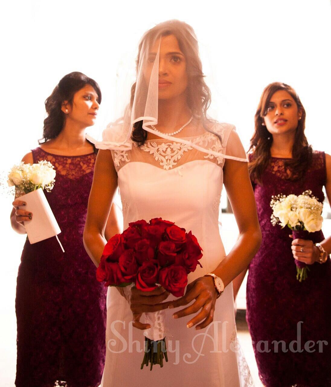 8_Custom designed wedding gown and bridesmaid's dresses.....
