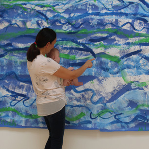 Young visitor sees work created by older children