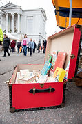 Old red suitcase with books. Town hall B