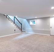 Light grey and spacious basement area wi