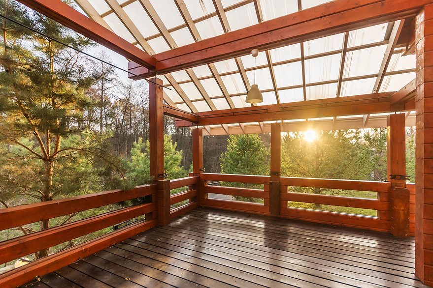 Large Porch of the log cabin at sunset w