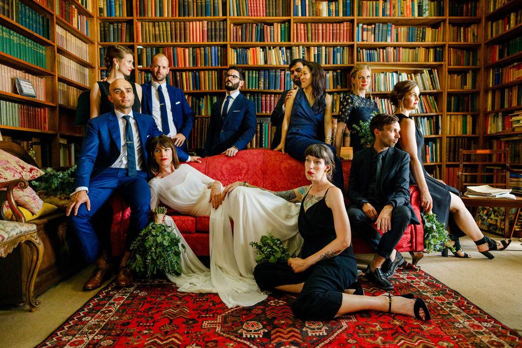 Bridal party posing in library of wedding venue in Sintra