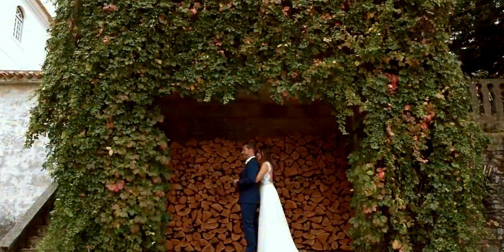 Bride embracing groom at first look photoshoot