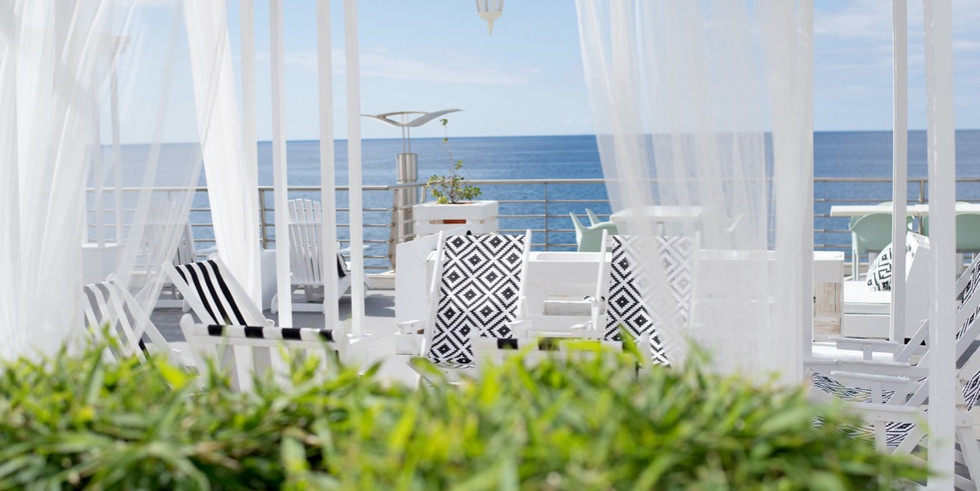 Wedding backdrop with white curtains and ocean view