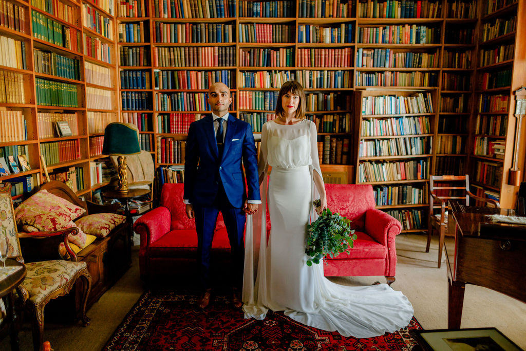 Bride and groom in library from Portuguese wedding venue