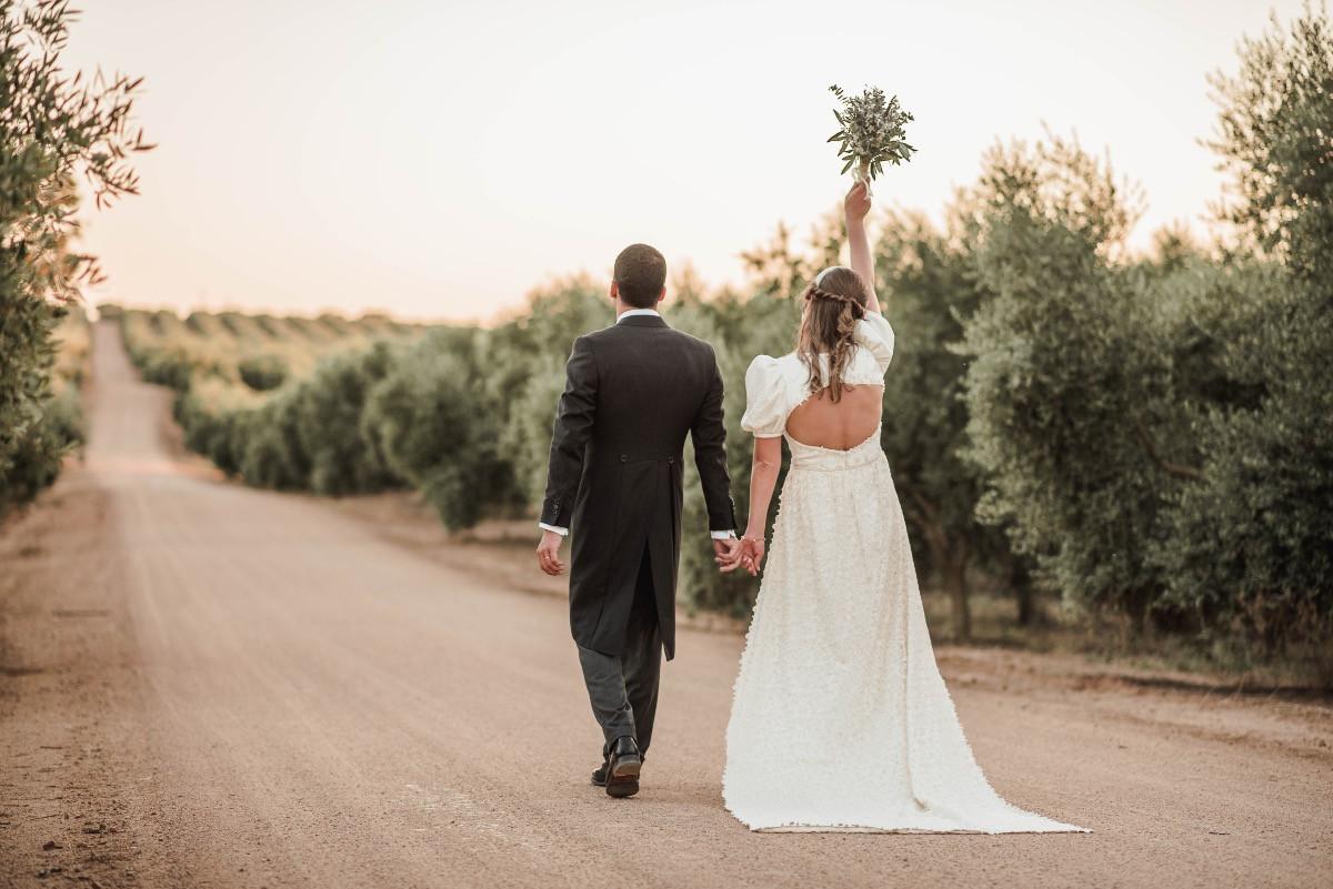 Bride & groom walking through Portuguese olive groove