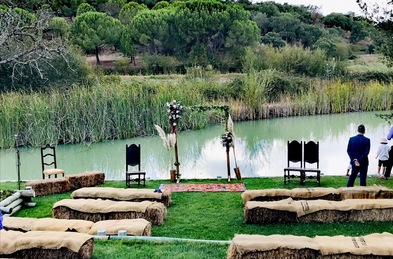 Symbolic wedding ceremony at the lake in barn style
