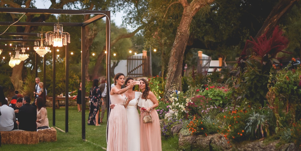 Bride and bridesmaids making selfie during cocktail