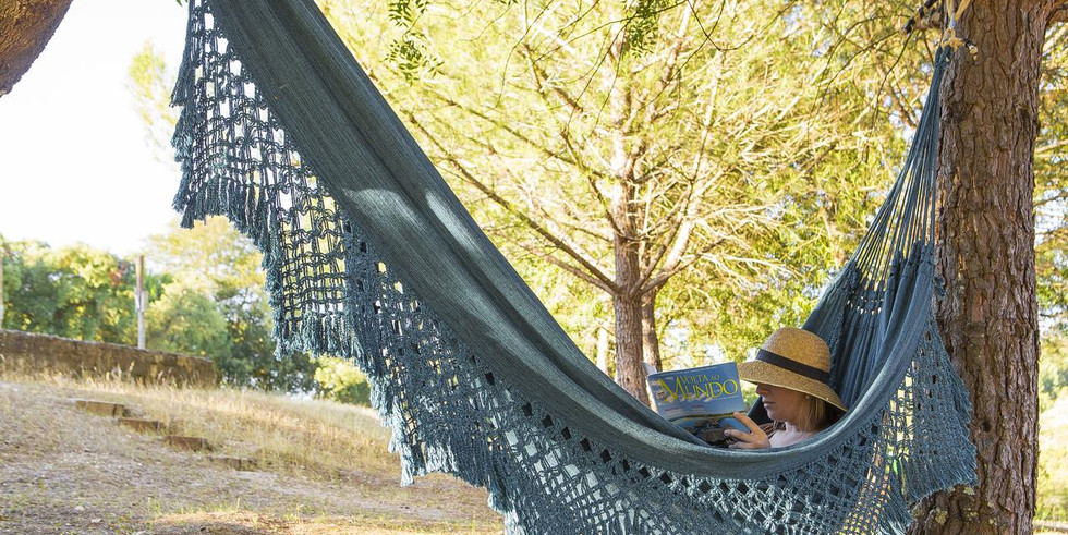 Guest reading a book in a hammock