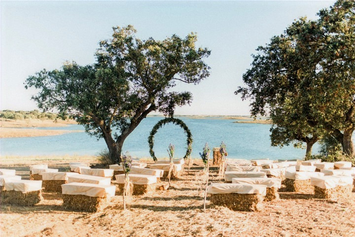 Rustic ceremony setting with lake view in Alentejo