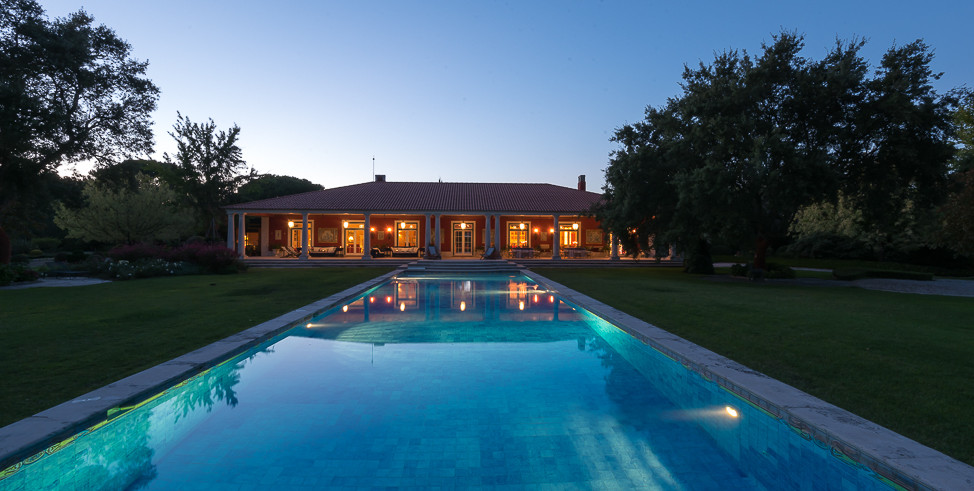 Swimmingpool and venue by night in Portugal