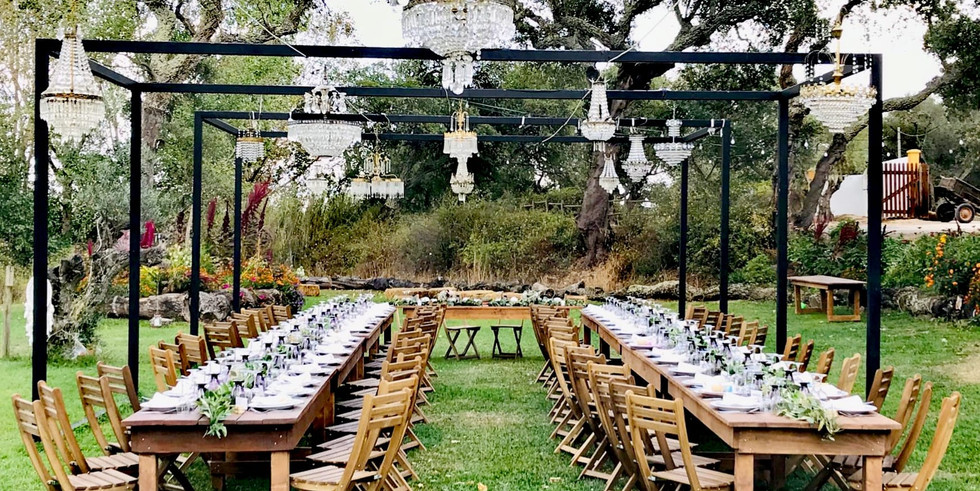 Outdoor dinner setting with chandeliers