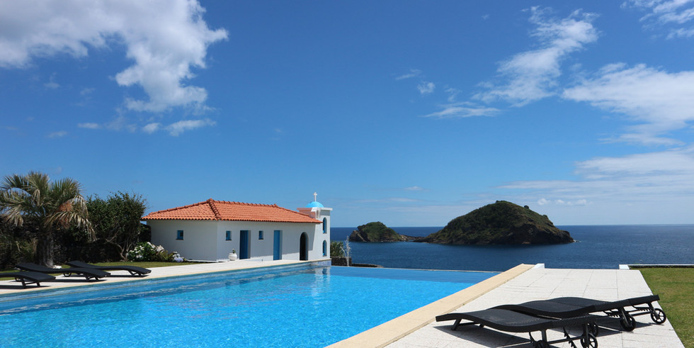 Infinity pool with characteristic chapel and sea view