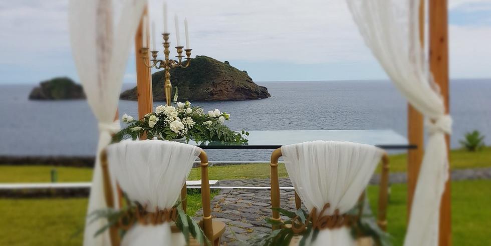 Ceremony backdrop with sea view at wedding venue