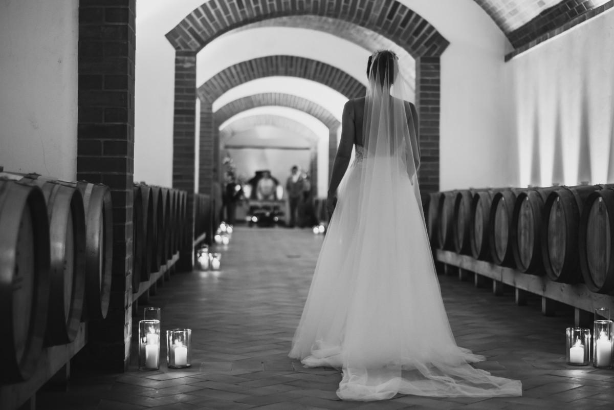 Bridel walking down the aisle in Portuguese winecellars