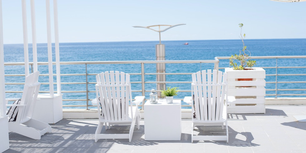 Two white sunbeds with ocean view at Casa de Praia in the Azores, Portugal
