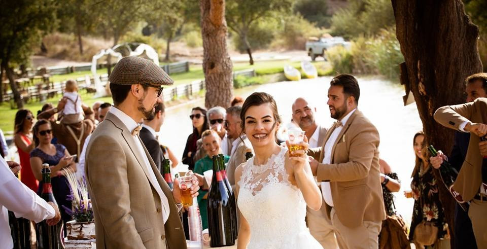 Bride and groom enjoying outdoor cocktail