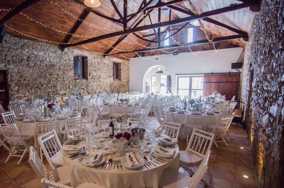 Indoor wedding dinner with round tables.jpg