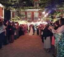 Bride and groom first dance with sparklers
