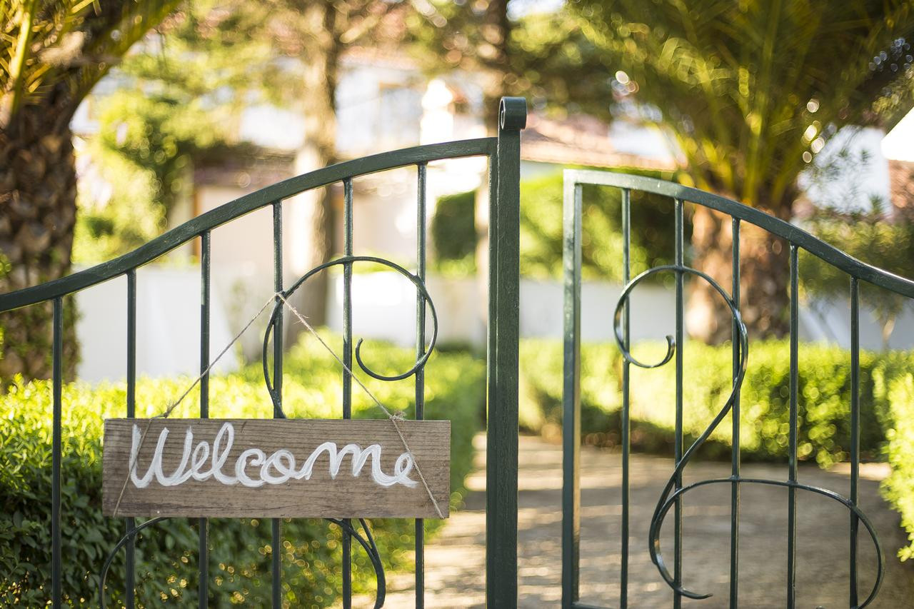 Outside gate of Portuguese wedding venue with welcome sign