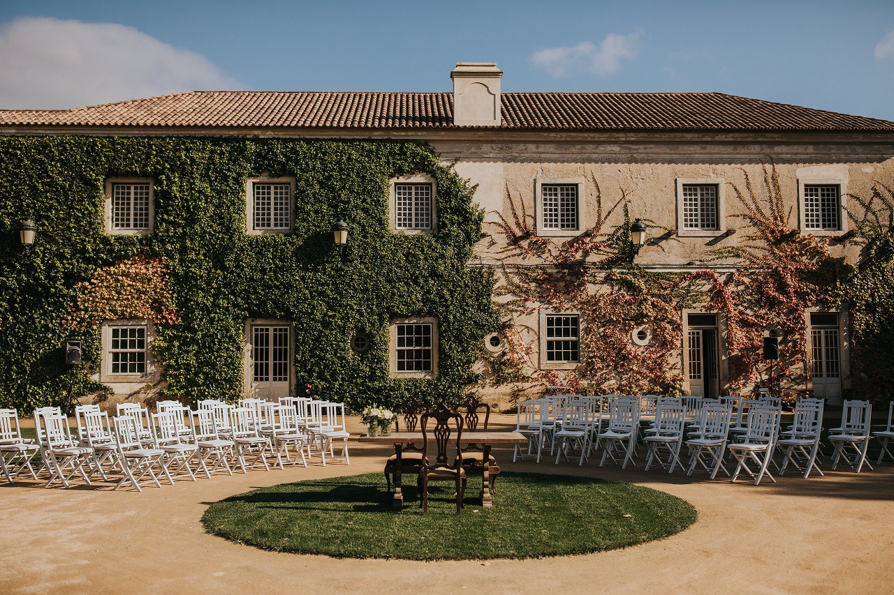 Outdoor ceremony setting in front of historical venue in Portugal