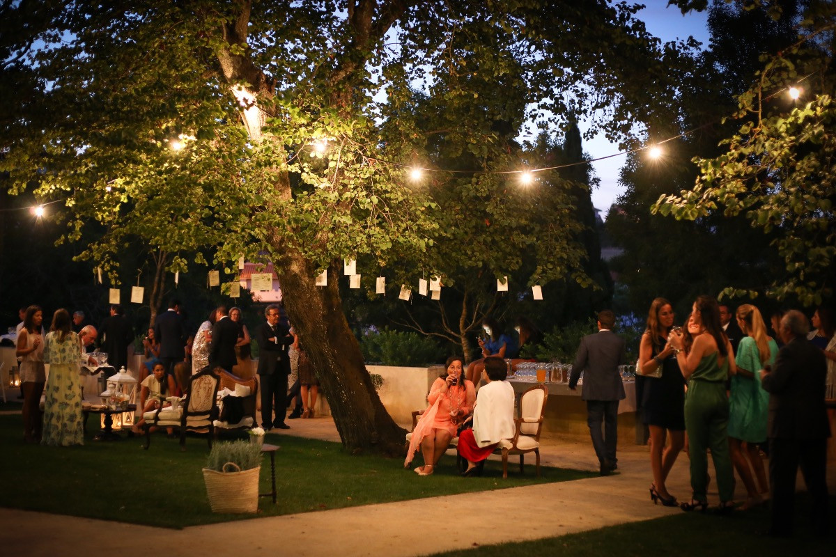 Outdoor wedding party decorated with fairylights