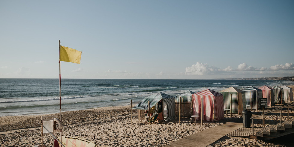 Portuguese beach with yellow flag