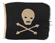 Skull and cross bones flag. Machine-sewn synthetic bunting. Ex Norwegian ship 'Christian Radich'. Made for the film 'Windjammer' circa 1962. - Emmanuel Isaiah Smith