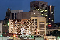 Floodlights illuminate the Albert P. Murrah Building after the 1995 bombing.