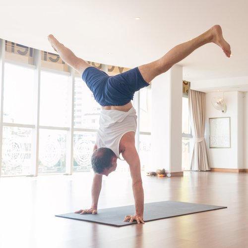 Adrian Cox yoga handstand