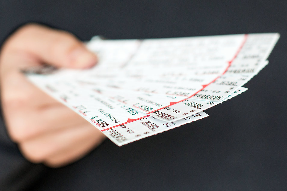 Tickets being held in a hand..jpg