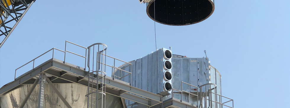 An above-roof cyclone during installation