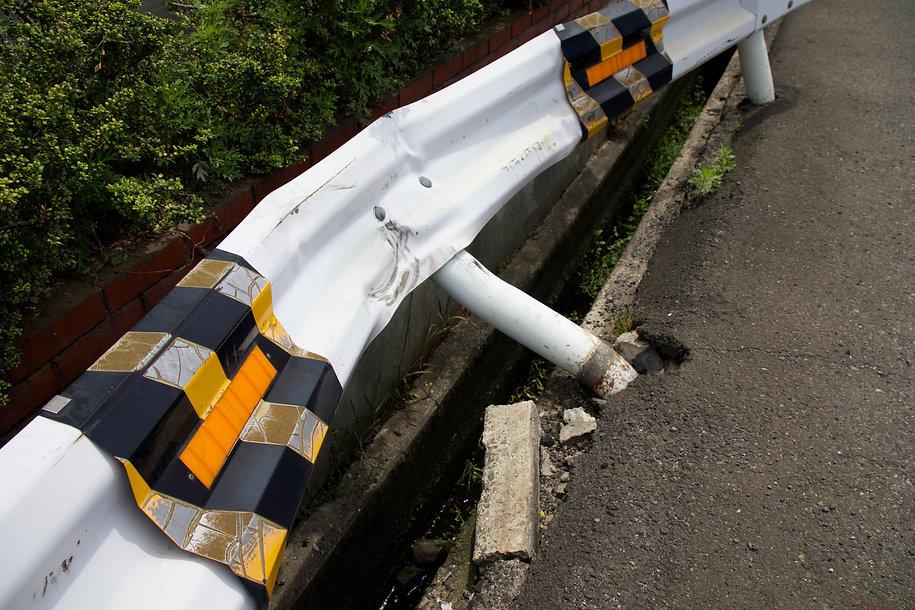 bent guard rail after wreck.jpg