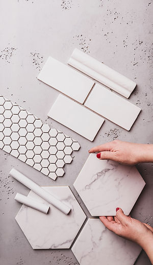 Interior design and home decoration - different shapes of white ceramic and gres tiles. De