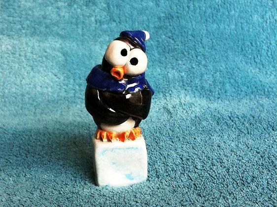 Penguin on Ice Cube