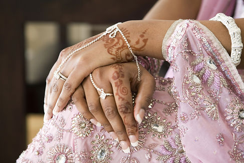 Bride's Hand With Henna Tattoo And Jewel
