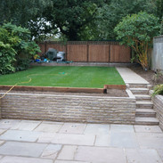 Sunken patio with steps and new lawn