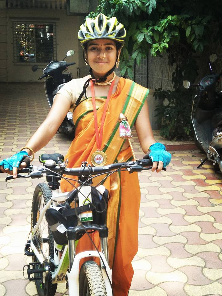 With her medal after finishing 60 km cycle competition on the occasion of Gudi Padwa.