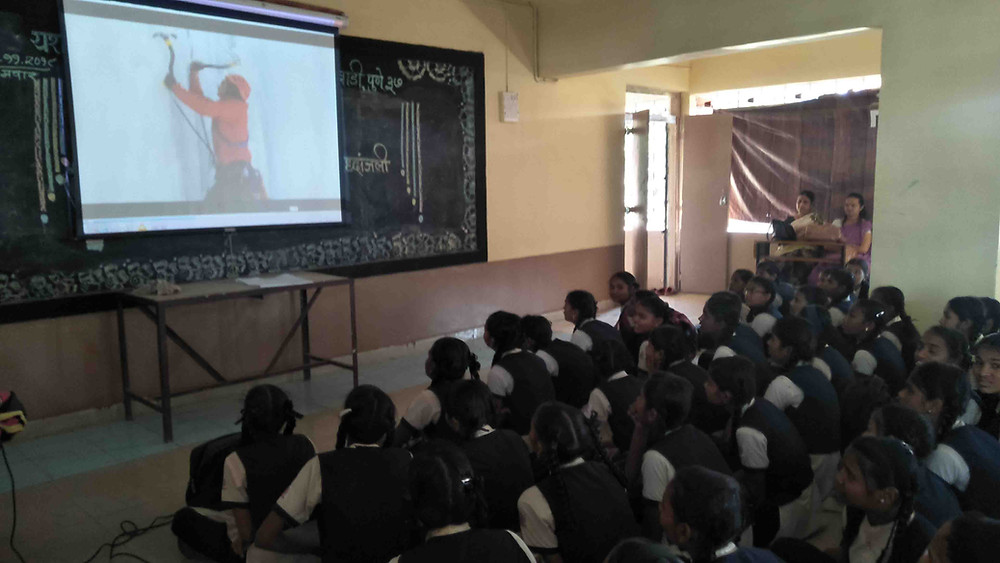Sayali showing Project Wild Women documentary at Yashwantrao Chavan Madhyamik Vidyalaya with the purpose of empowering girls through extreme and outdoor sports in India