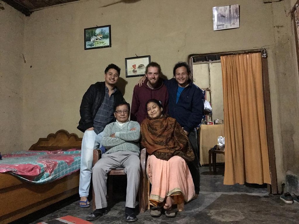 Amit with his parents, younger brother and a friend