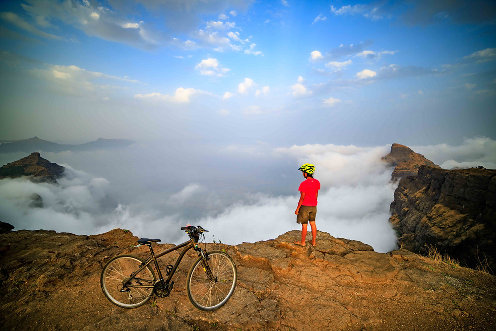 After completing her 50th Konkankada trek, Sayali with her bicycle on the top of Harishchandragad fort. Image Credit: Mayuresh Mokal
