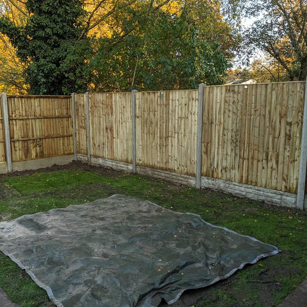 Featheredge panels with rock faced gravel boards in great Hollands.