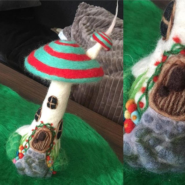 A needle felt wool fairy house